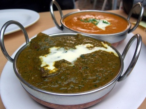 Lamb saag and chicken korma (photo by Flickr user avlxyz)